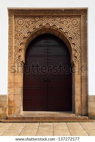 Morocco, Rabat, UNESCO World Heritage site - Beautiful historical Arabesque mosque doorway. Sandstone engraved.