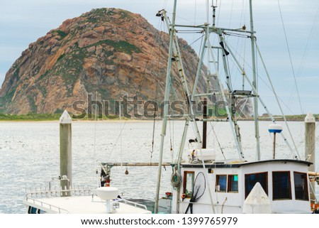 Morro Bay harbor, beautiful seascape with sailing boat and Morro Rock at Morro Bay State Park, California