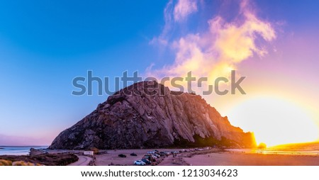 Morro Bay is a coastal city in California. It's known for Morro Rock, an ancient volcanic mound at the end of Morro Rock Beach. The rock sits within Morro Bay State Park, home to lagoons,