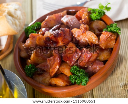 Morro de cerdo, appetizing braised pork snout garnished with fresh parsley