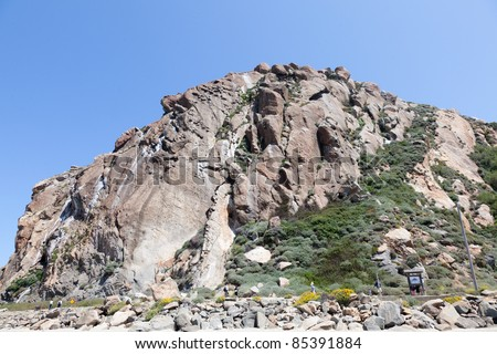 Morro Rock is a 581-foot (177 m) volcanic plug located just offshore from Morro Bay, California