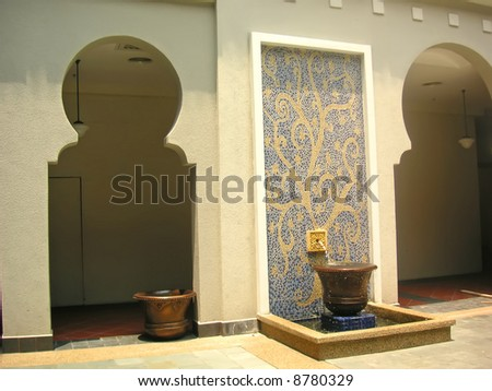 Morroccan style architectural details door entrance and mosaic fountain