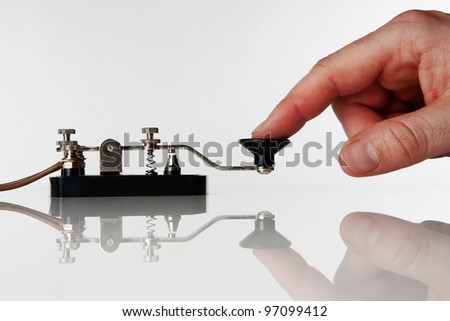 morse code key on a white background with someone sending a message