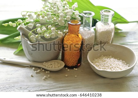 Mortal, drags, bottles, spoon , homeopathy medicine  Stock photo ©