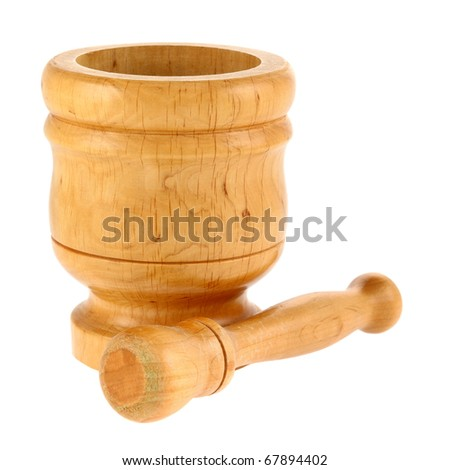 Mortar and pestle isolated on white background. Intentional shallow depth of field. Focus on foreground. Studio work.