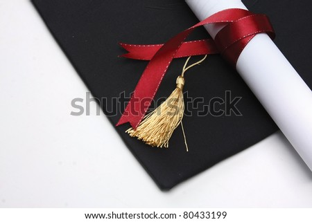 mortar board and the roll of diploma