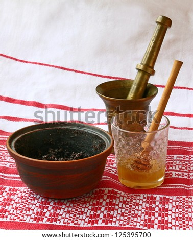 "Mortar, glass with honey and bowl with a poppy. Preparation of traditional sacral porridge ""kutya"" in eve Christmas"