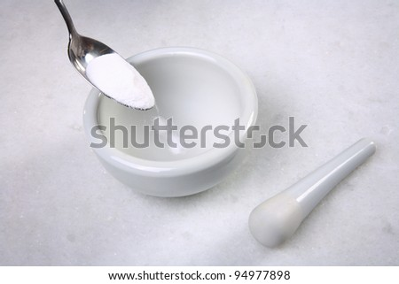 mortar pestle and  spoon with powder closeup