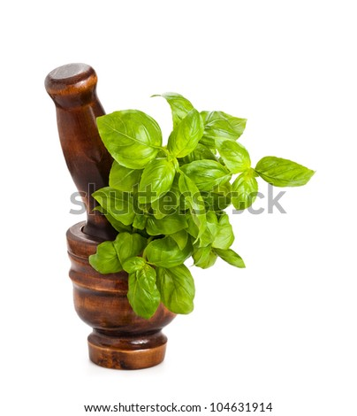 Mortar with basil isolated on white