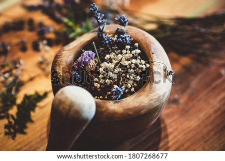 Mortar with dried healing herbs and flowers, ritual purification and cleansing, closeup Foto stock ©
