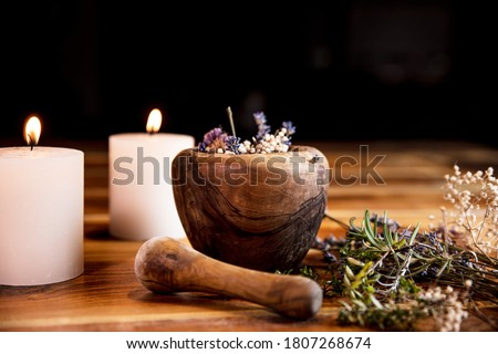 Mortar with dried healing herbs, flowers and candles, ritual purification and cleansing, copyspace Stock fotó ©