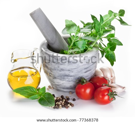 Mortar with pestle and basil herbs and olive oil. - stock photo