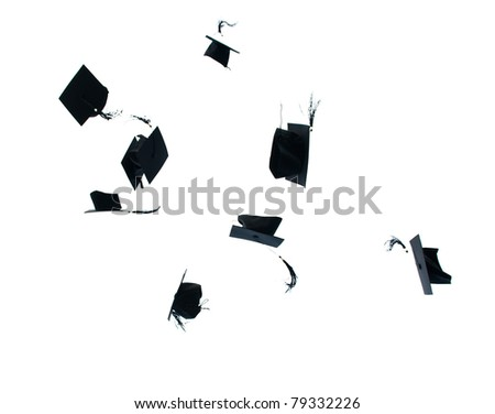 Mortarboards tossed in the air at graduation - stock photo