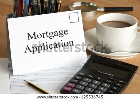 Mortgage application concept with envelope, calculator and pencil