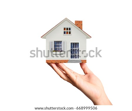 Mortgage concept by house from in hand  #668999506