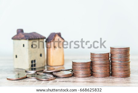 Mortgage concept by money house from coins, ,finance and loan background concept