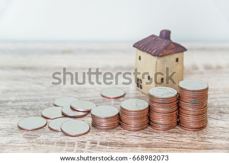 Mortgage concept by money house from coins, ,finance and loan background concept #668982073