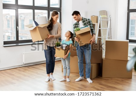 mortgage, family and real estate concept - happy mother, father and little daughter with stuff in boxes moving to new home