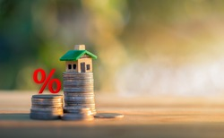 Mortgage rates business concept of investment housing real estate interest rates 3d home appraisal. planning savings money of coins to buy a home concept for property ladder, mortgage, real estate.