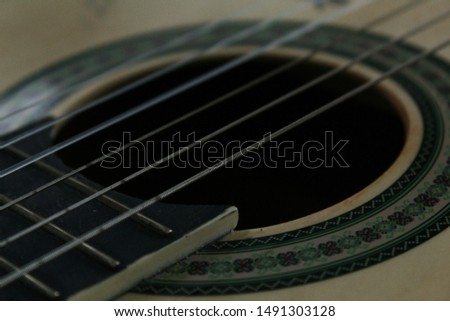 Mosaic and Strings of a Guitar