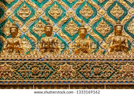 Mosaic encrusted wall of the Phra Mondop library building on the grounds of the Grand Palace Bangkok Thailand.