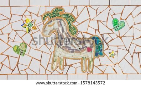Mosaic horse, star, heart on tile background. Mosaic horse. Mosaic pegasus.