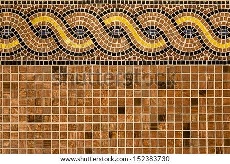 Mosaic in ancient style stacked with tiny brown, yellow, blue tiles. Background with mosaic tiles with ornament.