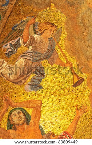 Mosaic of an angel with trumpet announcing the coming of God executed in golden mosaics - stock photo