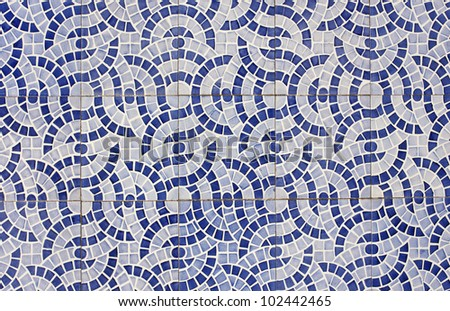 Mosaic of old tiles with abstract design in two shades of blue