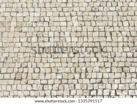 Mosaic pavers of small stones. Abstract background of old cobblestone pavement close-up.  Foto stock ©