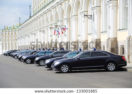 MOSCOW - APR 24: Black government cars with flashers are near Grand Kremlin Palace, Apr 24, 2012 Moscow Russia. Armored limousines Mercedes-Benz S600 (model of Vladimir Putin) weigh from 3 to 3.5 tons
