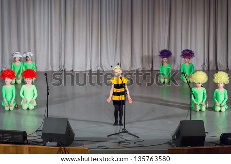 MOSCOW - APR 4: Girl in costumes of bee and girls in costumes of flowers performs on stage on District Competition Crystal droplet on April 7, 2012 in Moscow, Russia.