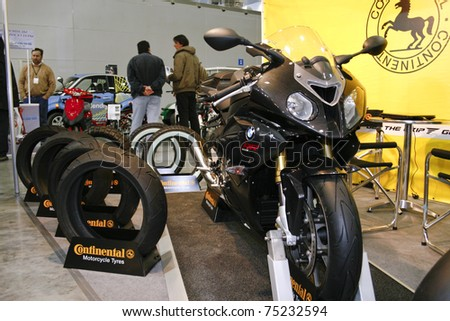MOSCOW - APRIL 1: BMW S1000RR and Continental tires at the Moscow specialized Exhibition  of motor cycling industry in Russia on April 1, 2011 in Moscow, Russia - stock photo