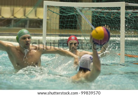 MOSCOW - APRIL 6: Goalkeeper Dmitry Dudkin Sintez  in the game Dynamo-CST Moscow (white) vs Sintez Kazan (green) of waterpolo Championship of Russia on April 6, 2012 Moscow, Russia. Sintez won 11:10