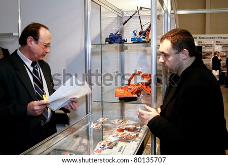 MOSCOW - APRIL 13: Men discuss mining equipment at the international exhibition of  the Mining and Processing of Metals and Minerals, MiningWorld on April 13, 2011 in Moscow