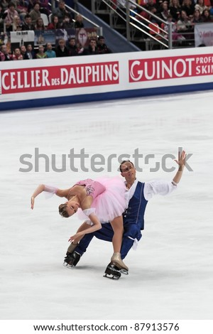 """MOSCOW - APRIL 30: Nelli Zhiganshina and Alexander Gazsi  compete in a pairs ice dancing routine during the 2011 World championship figure skating at the Palace of Sports """"Megasport"""" on April 30, 2011 in Moscow, Russia."""