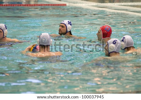 MOSCOW - APRIL 6: Players of Dynamo team just before a game Dynamo-CST Moscow (white) vs Sintez Kazan (green) of waterpolo Championship of Russia on April 6, 2012 Moscow, Russia. Sintez won 11:10