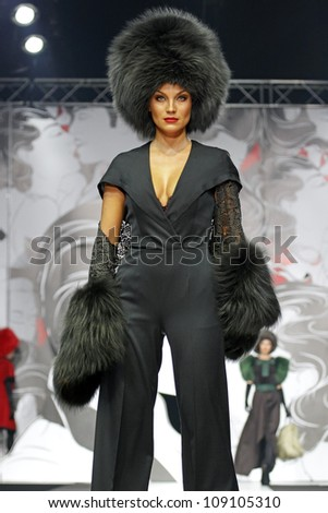 MOSCOW - APRIL 5: The model walks a runway in a collection of Igor Gulyaev, autumn-winter 2012/13 Volvo Fashion Week April 5, 2012 in Moscow, Russia - stock photo
