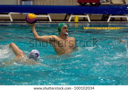 MOSCOW - APRIL  6: Unidentified player during a game Dynamo(white) vs Sintez (green) of waterpolo Championship of Russia on April 6, 2012 Moscow, Russia. Sintez won 13:10