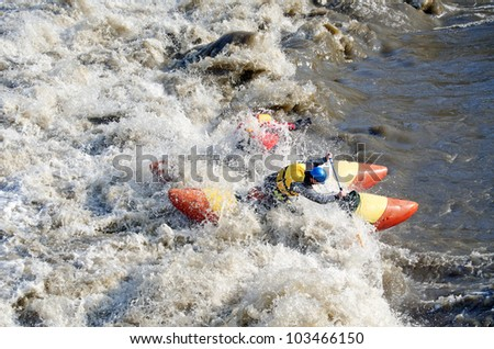 "MOSCOW - APRIL 14: Unidentified sportsmen train in whitewater rafting techniques in Pakhra river during a traditional spring meeting ""Pakhra 2012"" on April 14, 2012 in Moscow, Russia."