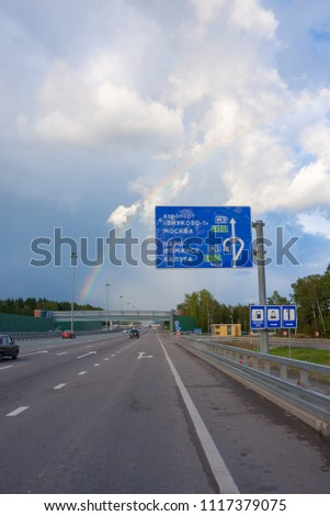 MOSCOW – AUGUAST 19, 2010: View on rainbow over vanishing Kievskoe Shosse Street with traffic on August 19, 2010 in Moscow. #1117379075