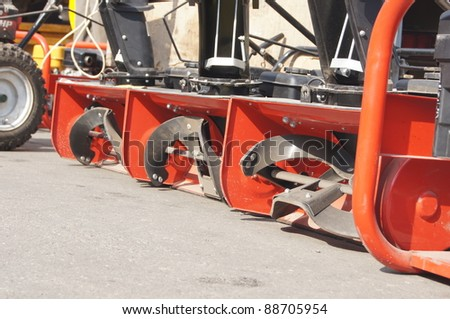 """MOSCOW - AUGUST 30: Red manual snow-plows on """"review of technics and the equipmentfor cleaning"""" for preparation for winter in area Butyrsky on August 30, 2011 in Moscow, Russia."""