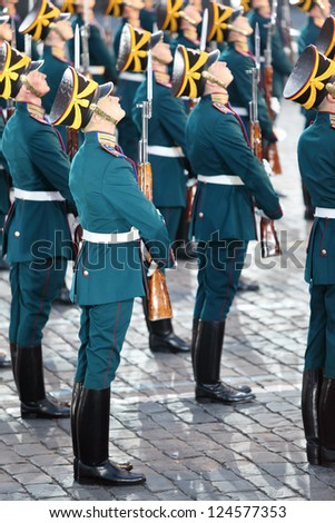 MOSCOW - AUGUST 31: Soldiers with guns of honor guard of Presidential Regiment at Military Music Festival Spasskaya Tower on August 31, 2011 in Moscow, Russia.