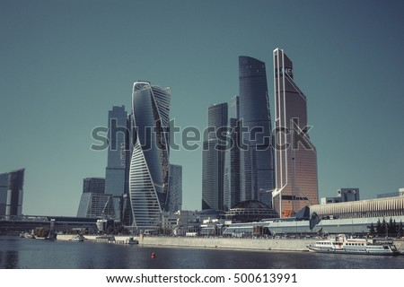 Moscow city, close up panorama of international business Russian Center. Good weather, blue sky. Construction buildings like a UAE, Arabic, USA style. Vintage, retro design photo, poster, image.