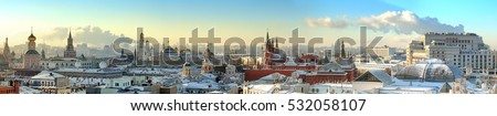 Moscow city historical skyline panorama winter snow building street kremlin tower red square university church cathedral government building hotel roof russian winter low sun theme aerial view  #532058107