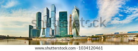 Moscow City skyline . Moscow International Business Centre at day time with Moskva river in foreground . High resolution Panorama #1034120461