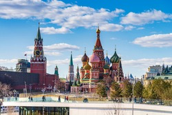 moscow city sunset, St. Basil's Cathedral and Kremlin Walls and Tower in Red square in sunny blue sky. Red square  is Attractions popular's touris in Moscow, Russia,