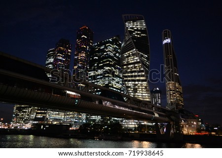 Moscow city towers and bridge at night: skyscrapers from glass