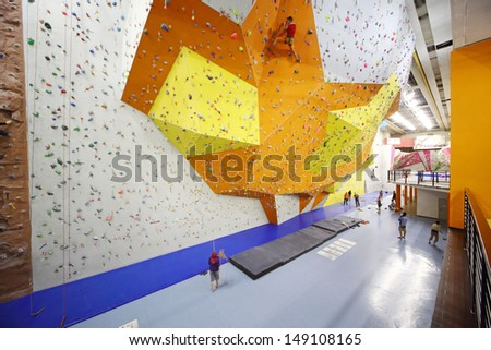 MOSCOW - DEC 5: Several people involved in climbing in a climbing gym Bigwall on Savelovskaya on December 5, 2012 in Moscow, Russia.