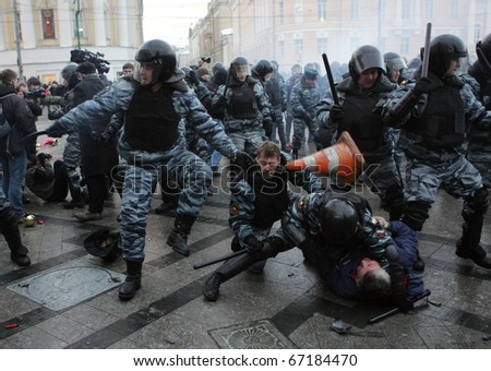 MOSCOW - DECEMBER 11: Police scuffle with protesters during a rally in central Moscow December 11, 2010. A few thousand people gathered to demand justice for Spartak Moscow fan Yegor Sviridov.